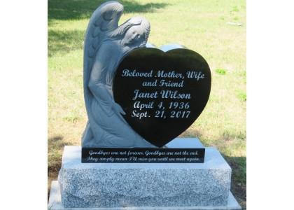 Installation d'un monument funéraire au Harcourt Cemetery, Harcourt, Ontario